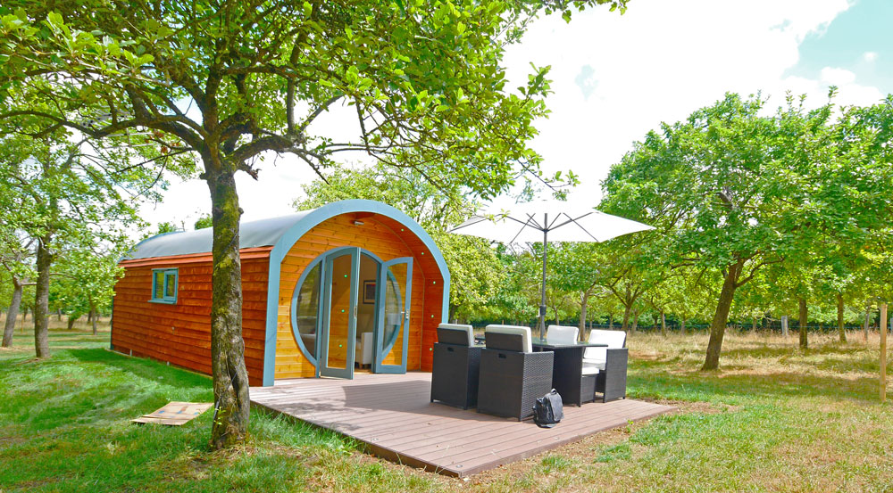 Outside of a deluxe glamping pod